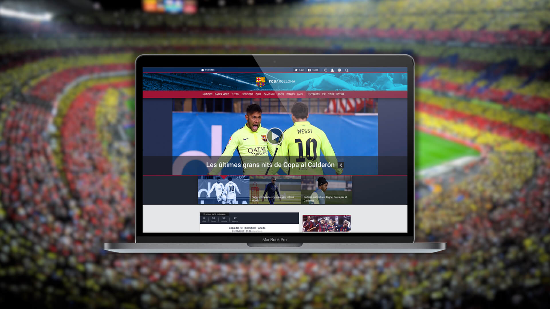 FCB web on a laptop and wallpaper with a blurry stadium image