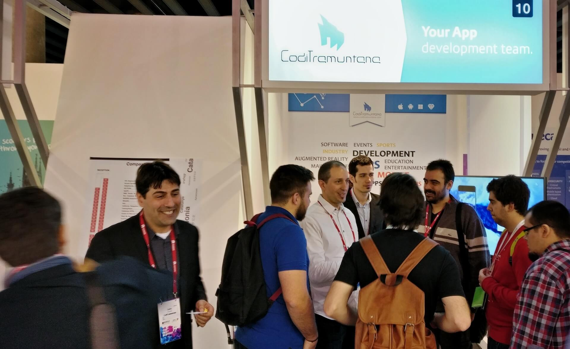 9 persons visiting the CodiTramuntana stand at MWC2017 of Barcelona
